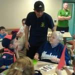 Leading Tiger Cub Scouts Den 6 (Pack 45) in scrapbooking activity with older adult residents of Watchung Terrace Community in Middlesex